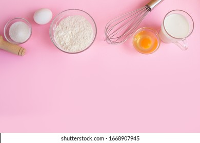 Frame of food ingredients for baking on a gently pink pastel background. Cooking flat lay with copy space. Top view. Baking concept.