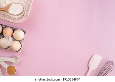 Frame of food ingredients for baking on a gently pink pastel background. Cooking flat lay with copy space. Top view. Baking concept. flat lay