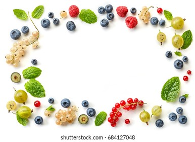 frame of fresh berries isolated on white background, top view