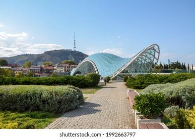 The frame of the glass Peace Bridge is a pedestrian bridge over the Kura river In Tbilisi, Georgia - Shutterstock ID 1992663797