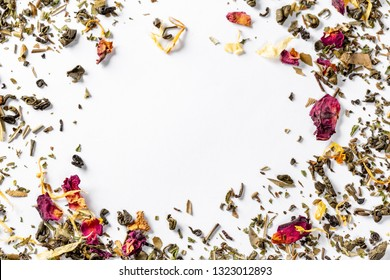Frame with green tea with dried flower petals and pieces of citrus. Dried tea for welding. Diet and healthy drink. Free space. Flatley. Top view