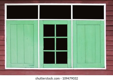 the frame of green window on brown wood
