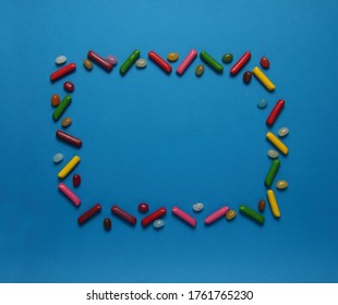 frame of gumdrops isolated on blue background flat lay