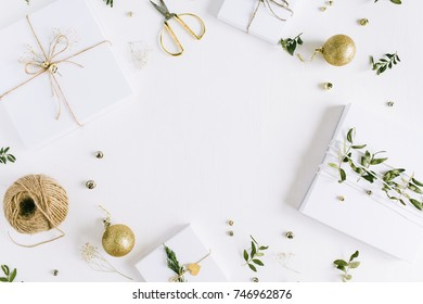 Frame of handmade Christmas gift boxes and festive decoration. Flat lay, top view holiday composition.