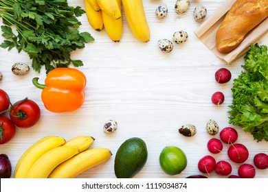 Frame of health food on a white wooden background. Healthy eating. Top view. From above. Flat lay. Copy space.