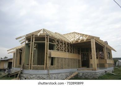 Frame house made of straw. Facade