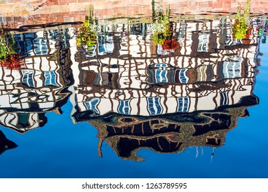 Frame House in Strasbourg (France) reflected in the water
