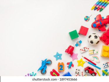 Frame of kids toys on white background with blank space for text. Top view, flat lay.