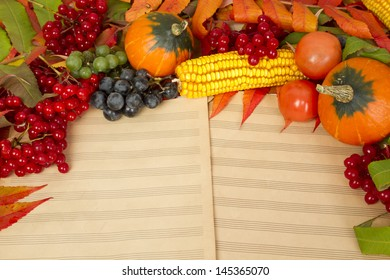 Frame of a large quantity of vegetables lying on a music sheet
