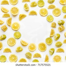 Frame with lemon and lime slices isolated on white background view from above