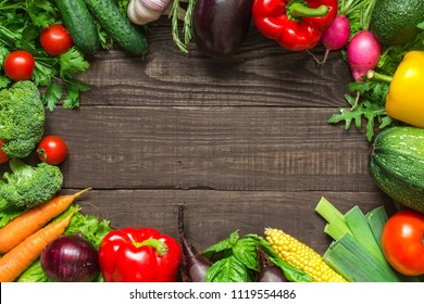 frame made of assortment of fresh harvested vegetables on the table. top view with copy space
