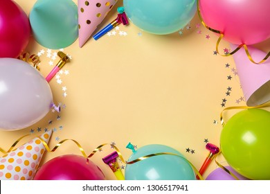 Frame made of balloons and party accessories on color background, top view with space for text