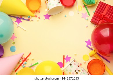 Frame made of Birthday decor on color background