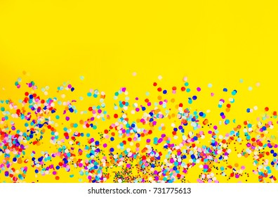 Frame made of colored confetti.