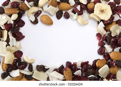 Frame made of dried fruits mix on white background