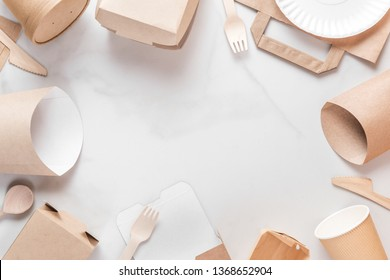frame made of eco friendly disposable tableware. Paper cups, dishes, bag, fast food containers and bamboo wooden cutlery. recycling concept. top view with copy space