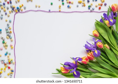 Frame made of flowers and stars on a white background, blank