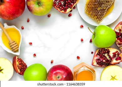 frame made of honey, apple and pomegranate. traditional food for Jewish New Year Holiday, Rosh Hashanah. top view with copy space
