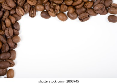 A Frame made out of coffeebeans. White background, but not isolated.