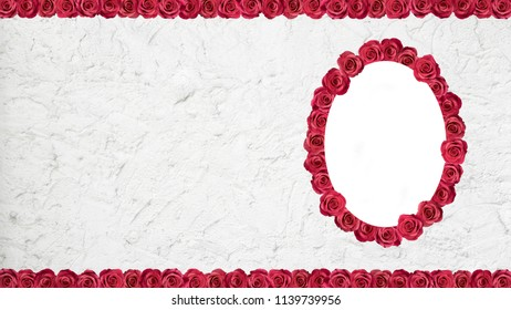 Frame made of pink roses on cement wall.