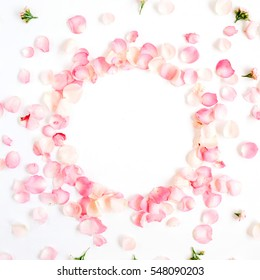 Frame made of pink roses petals on white background. Flat lay, top view. Valentine's background. Valentine's Day concept.