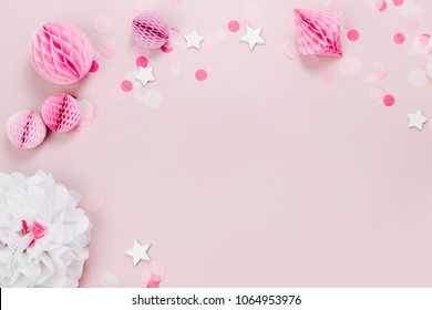 Frame made of Pink and white Paper Decorations for Baby party. Flat lay, top view