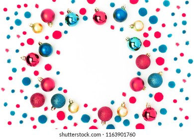Frame  made of red and green Christmas balls on white background. Flat lay, top view