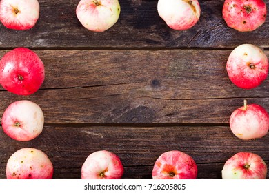 Frame made of red ripe apples on the vintage wooden table