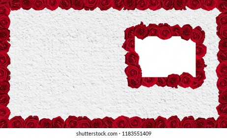 Frame made of red roses on plaster wall.