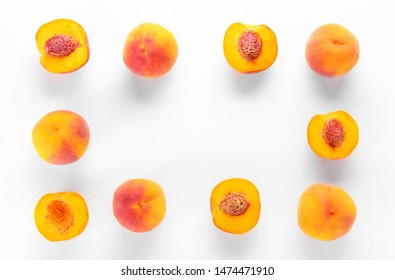 Frame made of ripe peaches on white background