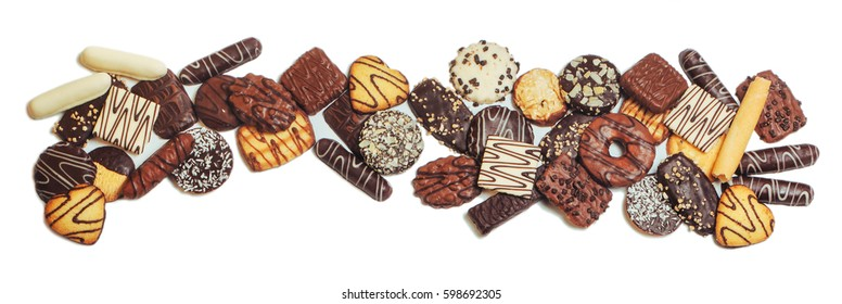 Frame of mixed biscuits covered with milk, dark and white chocolate isolated on white background with copy space; top view, flat lay