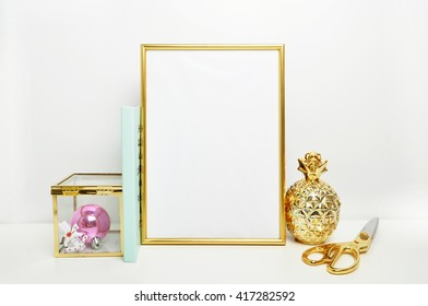 Frame mockup. Place for your photo or text and work, print art, shabby style, white background. Gold pineapple, gold picture frame with decorations.