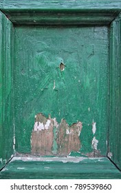 Frame of old cracked green colored wooden door.