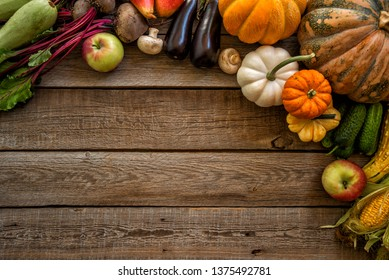Frame of organic food. Vegetables and fruits on vintage table.
