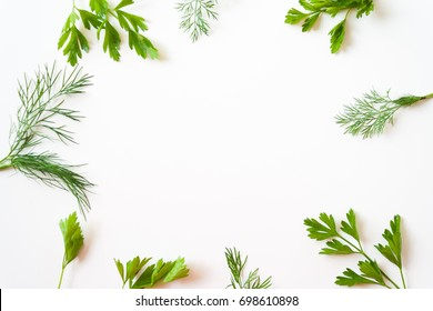 frame with parsley and dill on white background