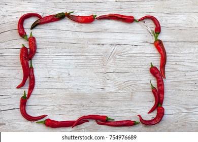 frame pepper on a wood board