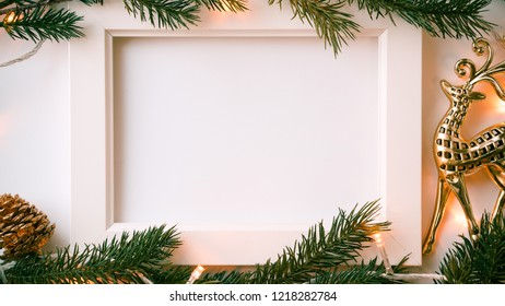 frame photo, pine branches, light and Christmas decoration for new year and Christmas concept background