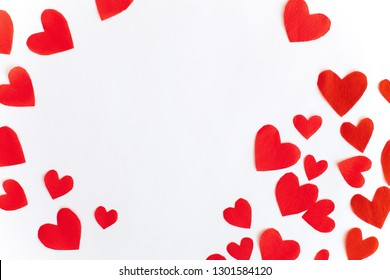 Frame of red paper hearts with space for text the centre on white background. Flat lay, top view Valentines Day background love concept.