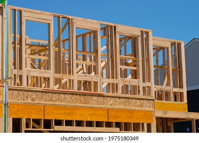 the frame of the second floor of a plywood house wall window