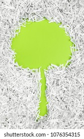 Frame in the shape of a tree made of shredded paper. Recycling and environment protection concept.