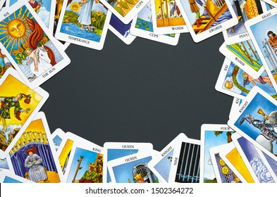 Frame of Tarot cards on dark background. - Image