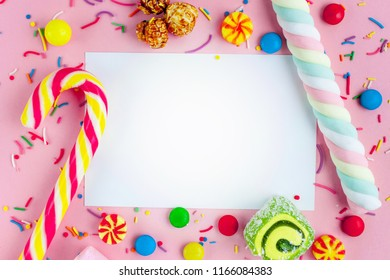 Frame for the text on the background of different, sugar, children's sweets. Candies on a pink background. Copy space, sweets concept