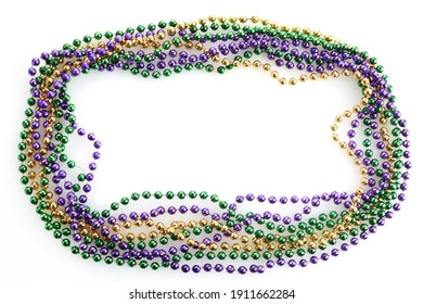 A frame of three colors of Mardi gras beads on white background