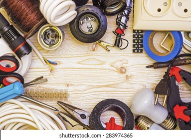 Frame tool electrician on a wooden background