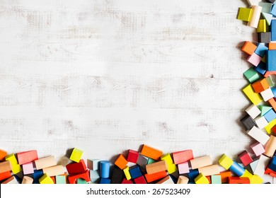 Frame of toy colored wooden bricks