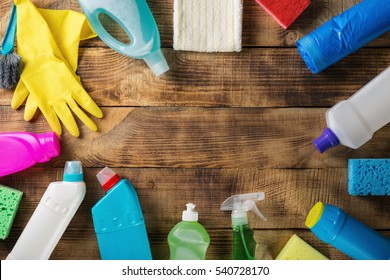 Frame of variety house cleaning product on wood table.