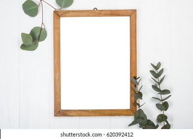 frame with a white background on wooden painted board