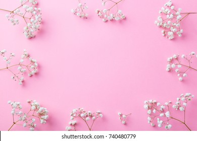 Frame of white flowers, gypsophila, Baby's Breath. Flat lay composition. Romantic concept. Top view. Copy space.