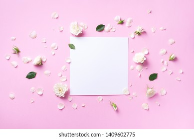 Frame of white flowers over pastel pink background. Valentines day, Woman day concept. Spring or summer banner with copy space.