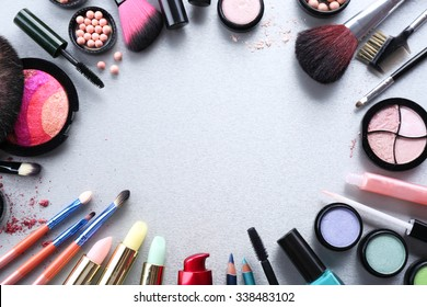 Frame of woman's decorative cosmetics on light background